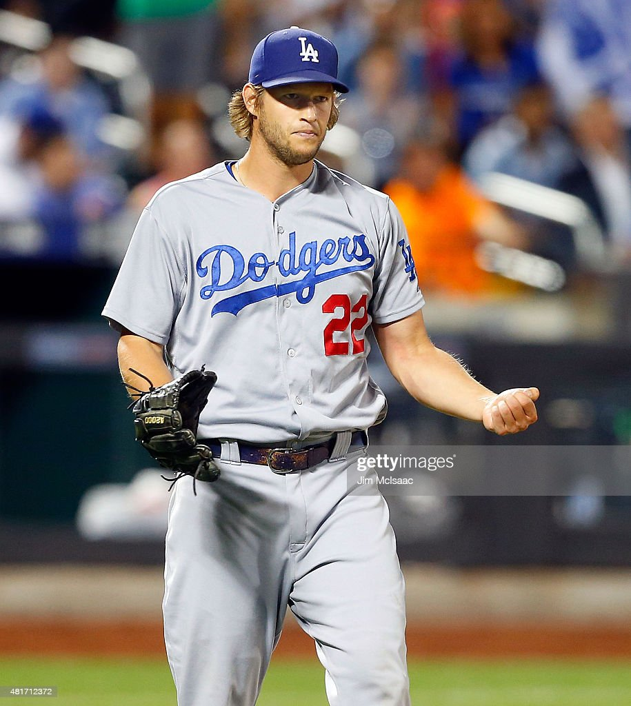 Clayton Kershaw of the Los Angeles Dodgers reacts after the final out of his 30 shutout against the New York Mets at Citi Field on July 23 2015 in...
