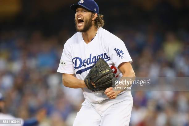 Clayton Kershaw of the Los Angeles Dodgers reacts during the fourth inning of Game One of the National League Championship Series at Dodger Stadium...