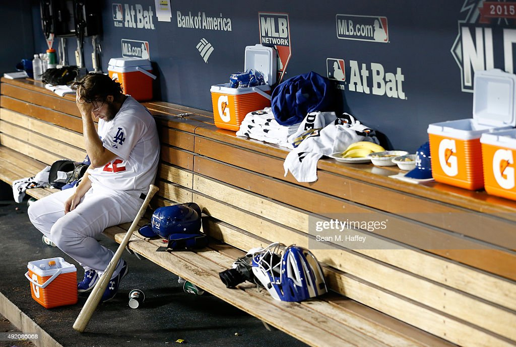 Clayton Kershaw #22 of the Los Angeles Dodgers reacts in the dugout after being taken out of the game in the seventh inning against the New York Mets in game one of the National League Division Series at Dodger Stadium on October 9, 2015 in Los Angeles, California.