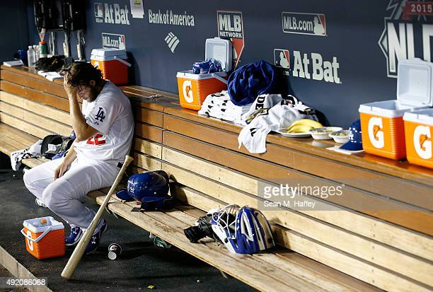 Clayton Kershaw of the Los Angeles Dodgers reacts in the dugout after being taken out of the game in the seventh inning against the New York Mets in...