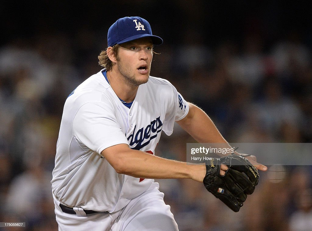 <a gi-track='captionPersonalityLinkClicked' href=/galleries/search?phrase=Clayton+Kershaw&family=editorial&specificpeople=4391635 ng-click='$event.stopPropagation()'>Clayton Kershaw</a> #22 of the Los Angeles Dodgers reacts to a Brandon Phillips #4 of the Cincinnati Reds double during the seventh inning at Dodger Stadium on July 26, 2013 in Los Angeles, California.