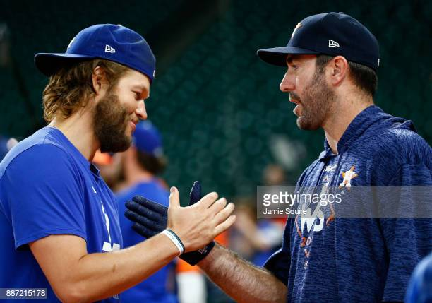 Clayton Kershaw of the Los Angeles Dodgers shakes hands with Justin Verlander of the Houston Astros before game three of the 2017 World Series at...