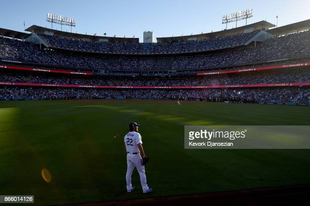 Clayton Kershaw of the Los Angeles Dodgers stands in the outfield before game one of the 2017 World Series against the Houston Astros at Dodger...
