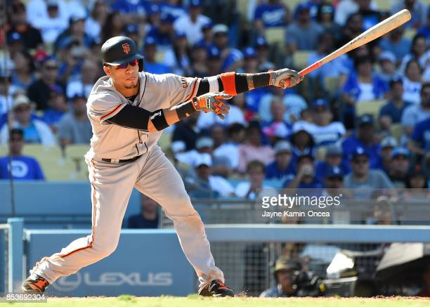 Clayton Kershaw of the Los Angeles Dodgers strikes out Gorkys Hernandez of the San Francisco Giants with his final pitch of the eighth inning to...