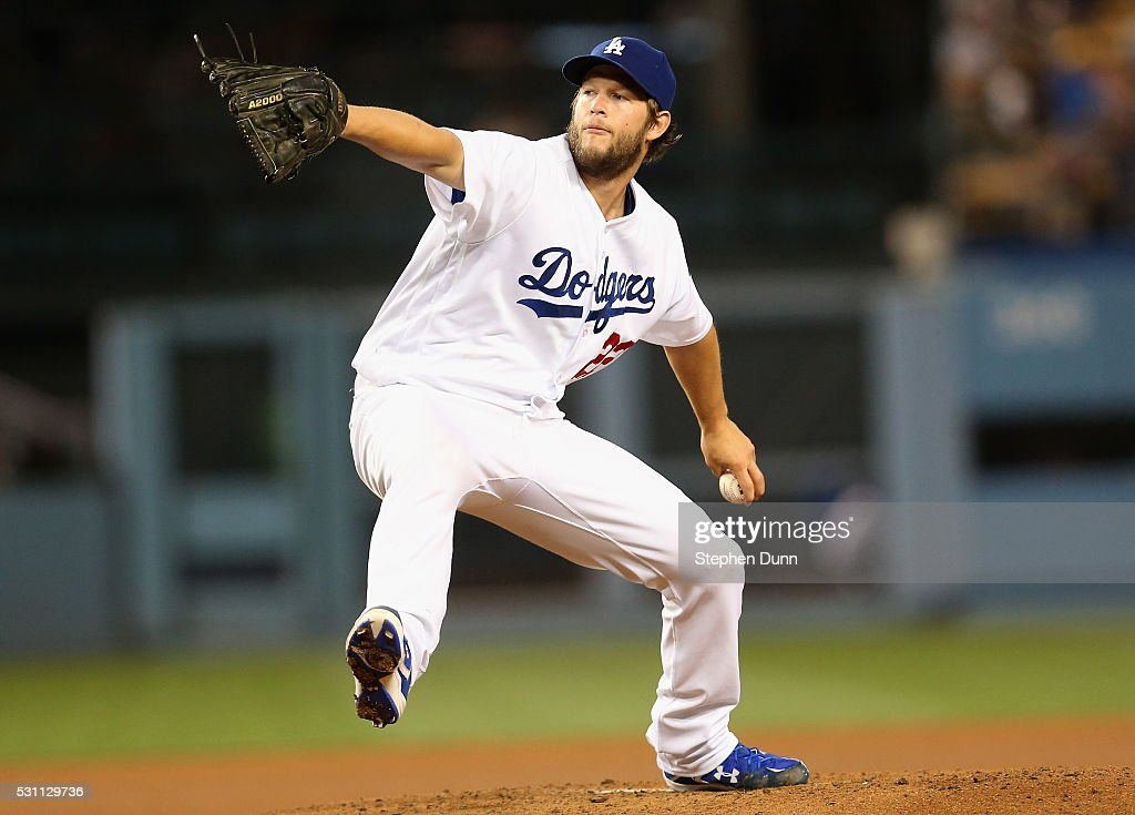 Clayton Kershaw of the Los Angeles Dodgers throws a pitch against the New York Mets at Dodger Stadium on May 12 2016 in Los Angeles California...