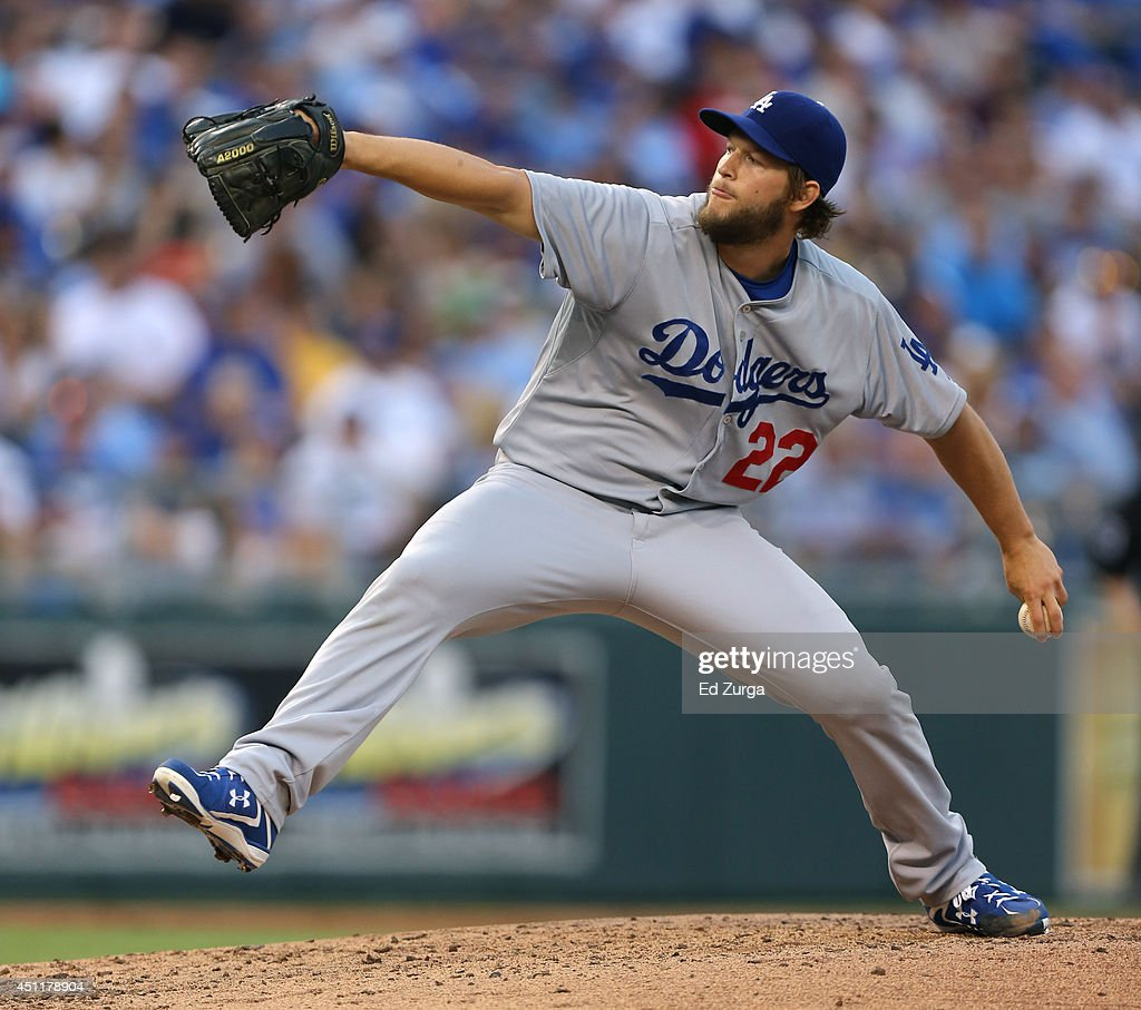 <a gi-track='captionPersonalityLinkClicked' href=/galleries/search?phrase=Clayton+Kershaw&family=editorial&specificpeople=4391635 ng-click='$event.stopPropagation()'>Clayton Kershaw</a> #22 of the Los Angeles Dodgers throws in the third inning against the Kansas City Royals at Kauffman Stadium on June 24, 2014 in Kansas City, Missouri.