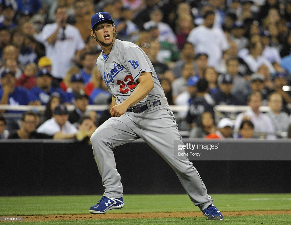 <a gi-track='captionPersonalityLinkClicked' href=/galleries/search?phrase=Clayton+Kershaw&family=editorial&specificpeople=4391635 ng-click='$event.stopPropagation()'>Clayton Kershaw</a> #22 of the Los Angeles Dodgers throws to first but can't get the out on Chris Denorfia #13 of the San Diego Padres during the fifth inning of a baseball game at Petco Park on June 21, 2013 in San Diego, California.
