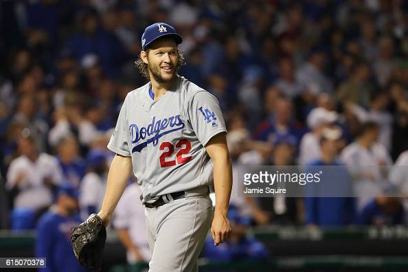 Clayton Kershaw of the Los Angeles Dodgers walks off the field after pitching the seventh inning against the Chicago Cubs during game two of the...