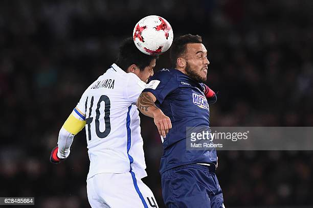 Clayton Lewis of Auckland City competes for the ball against Mitsuo Ogasawara of Kashima Antlers during the FIFA Club World Cup Playoff for Quarter...