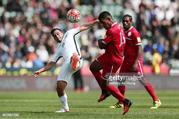 Clayton Lewis of New Zealand competes against Roy Kayara of New Caledonia during the 2018 FIFA World Cup Qualifier match between the New Zealand All...