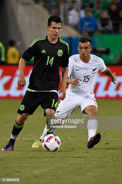 Clayton Lewis of New Zealand plays against Hirving Lozano of Mexico at Nissan Stadium on October 8 2016 in Nashville Tennessee