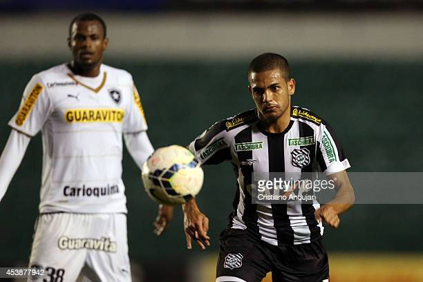 Clayton of Figueirense run to the ball looked by Airton of Botafogo during a match between Figueirense and Botafogo as part of Campeonato Brasileiro...