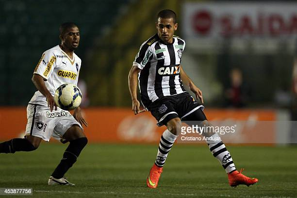 Clayton of Figueirense takes the ball with Junior Cesar of Botafogo behind him during a match between Figueirense and Botafogo as part of Campeonato...