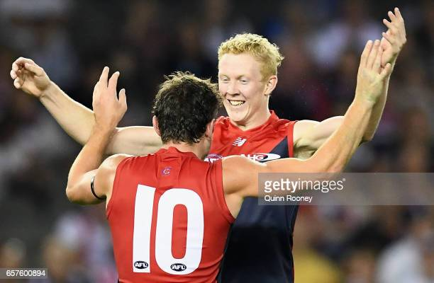 Clayton Oliver and Angus Brayshaw of the Demons celebrates a goal during the round one AFL match between the St Kilda Saints and the Melbourne Demons...