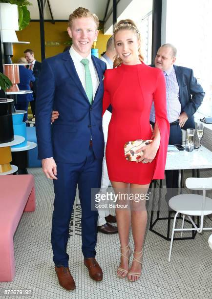 Clayton Oliver and Sophie Harmer pose at the Myer Marquee on Stakes Day at Flemington Racecourse on November 11 2017 in Melbourne Australia