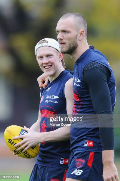 Clayton Oliver gets a hug from Max Gawn during a Melbourne Demons AFL training session at Gosch's Paddock on June 28 2017 in Melbourne Australia
