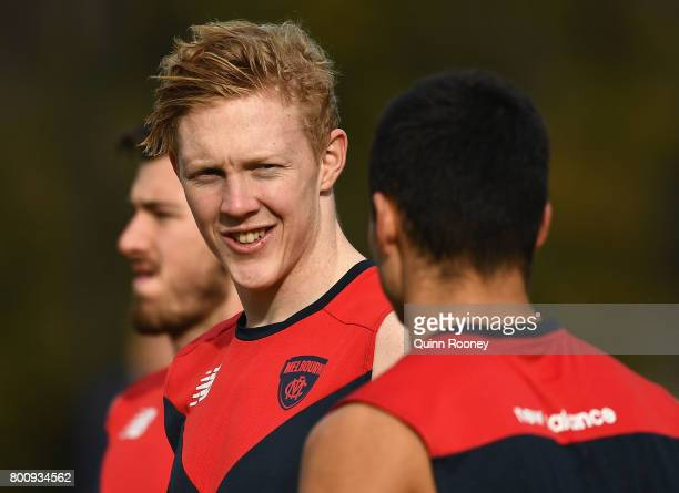 Clayton Oliver of the Demons chats to Billy Stretch during a Melbourne Demons AFL training session at Gosch's Paddock on June 26 2017 in Melbourne...