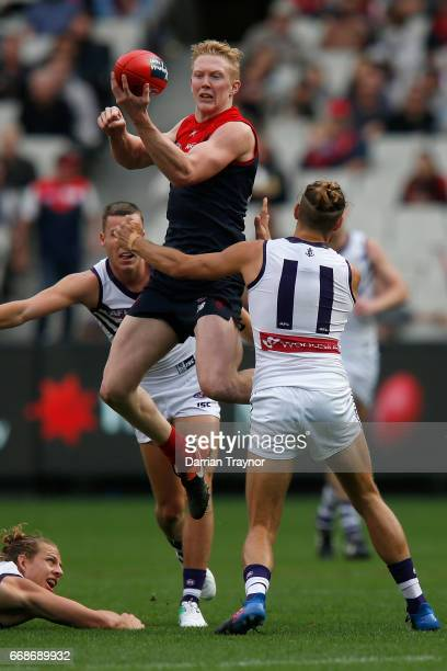 Clayton Oliver of the Demons handballs during the round four AFL match between the Melbourne Demons and the Fremantle Dockers at Melbourne Cricket...