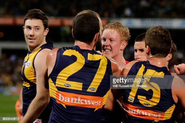 Clayton Oliver of the Demons has words with Will Schofield of the Eagles during the round 14 AFL match between the West Coast Eagles and the...
