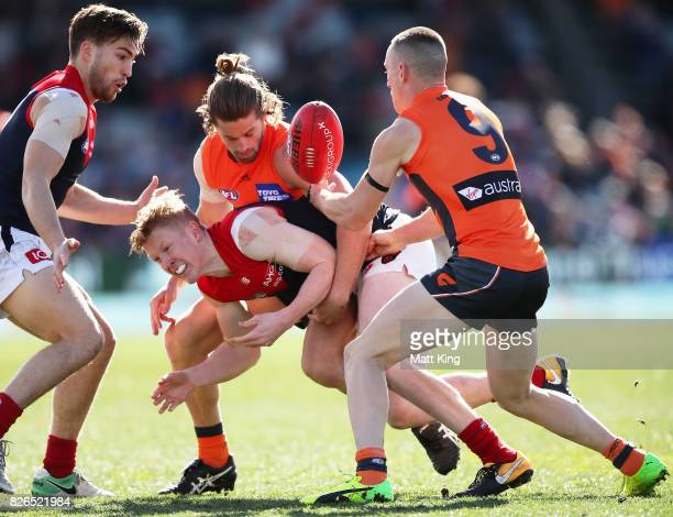 Clayton Oliver of the Demons is tackled during the round 20 AFL match between the Greater Western Sydney Giants and the Melbourne Demons at UNSW...