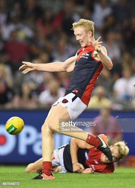 Clayton Oliver of the Demons kicks during the round one AFL match between the St Kilda Saints and the Melbourne Demons at Etihad Stadium on March 25...