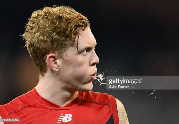 Clayton Oliver of the Demons looks dejected after losing the round 15 AFL match between the Melbourne Demons and the Sydney Swans at Melbourne...