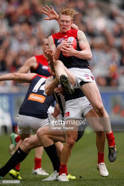 Clayton Oliver of the Demons marks the ball during the round 23 AFL match between the Collingwood Magpies and the Melbourne Demons at Melbourne...