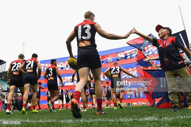 Clayton Oliver of the Demons runs out onto the field during the round nine AFL match between the Melbourne Demons and the North Melbourne Kangaroos...