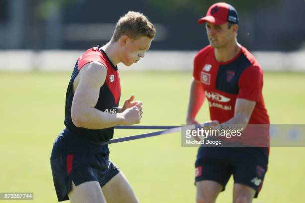 Clayton Oliver of the Demons runs with resistence from a band during a Melbourne Demons AFL training session at Gosch's Paddock on November 13 2017...