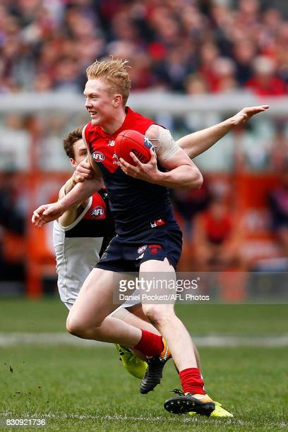 Clayton Oliver of the Demons runs with the ball during the round 21 AFL match between the Melbourne Demons and the St Kilda Saints at Melbourne...