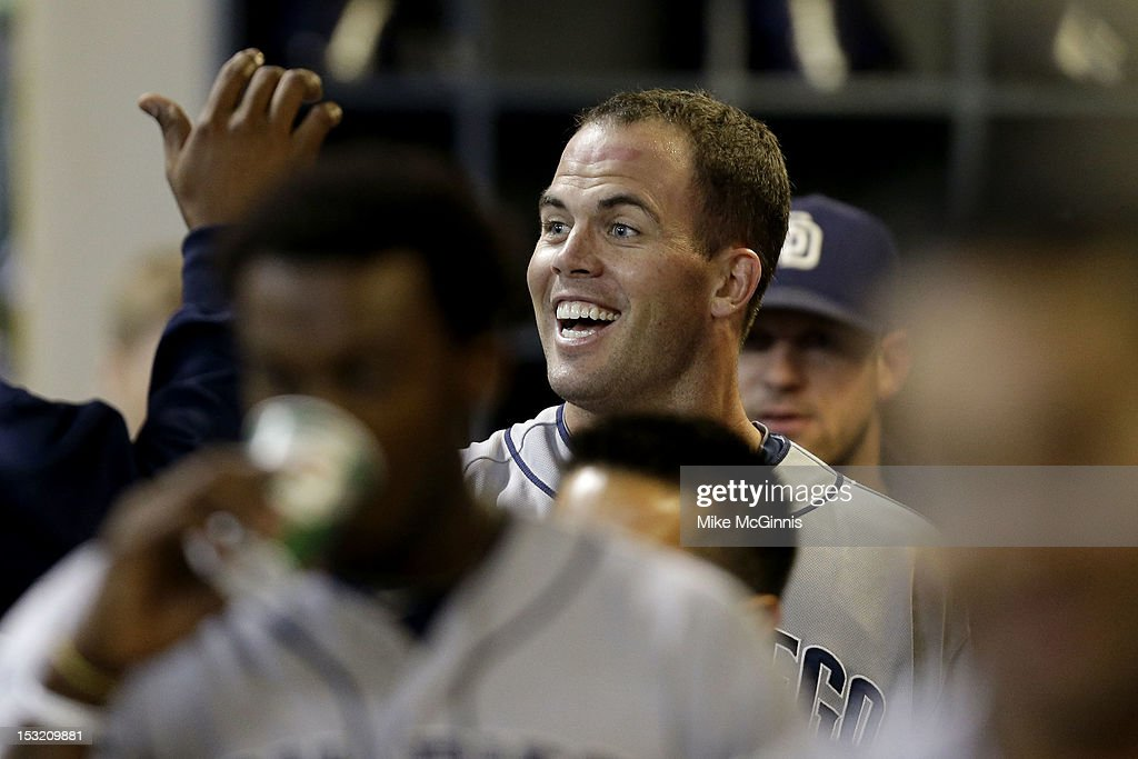 <a gi-track='captionPersonalityLinkClicked' href=/galleries/search?phrase=Clayton+Richard&family=editorial&specificpeople=5476063 ng-click='$event.stopPropagation()'>Clayton Richard</a> #33 of the San Diego Padres celebrates in the dugout after hitting a solo homer in the top of the 3rd inning against the Milwaukee Brewers at Miller Park on October 1, 2012 in Milwaukee, Wisconsin.
