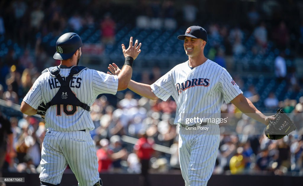 Clayton Richard #3 of the San Diego Padres, right, is congratulated by Austin Hedges #18 after getting the final out in the ninth inning of a baseball game against the Philadelphia Phillies at PETCO Park on August 16, 2017 in San Diego, California. The Padres won 3-0.