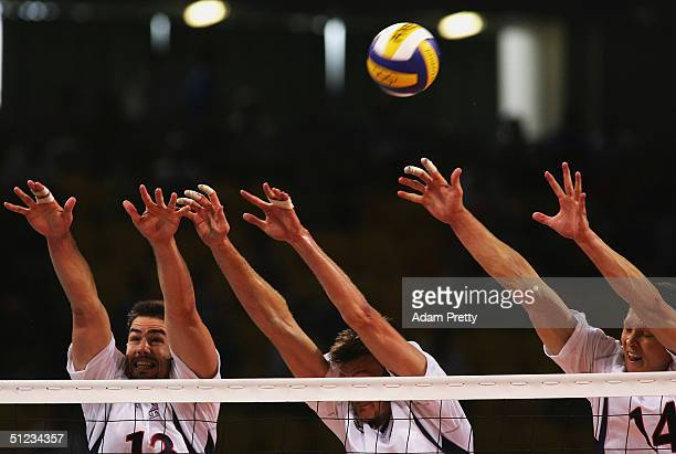Clayton Stanley Thomas Hoff and Kevin Barnett the United States jump to block the ball against Russia during the men's indoor Volleyball bronze medal...