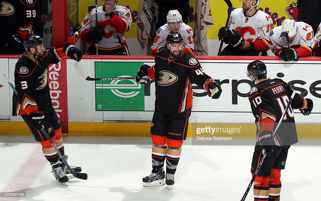 Clayton Stoner #3 and Corey Perry #10 of the Anaheim Ducks celebrate an empty-net goal by Nate Thompson #44 against the Calgary Flames during the third period in Game Two of the Western Conference Semifinals during the 2015 NHL Stanley Cup Playoffs at Honda Center on May 3, 2015 in Anaheim, California. The Ducks won 3-0.