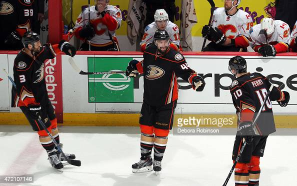 Clayton Stoner and Corey Perry of the Anaheim Ducks celebrate an emptynet goal by Nate Thompson against the Calgary Flames during the third period in...