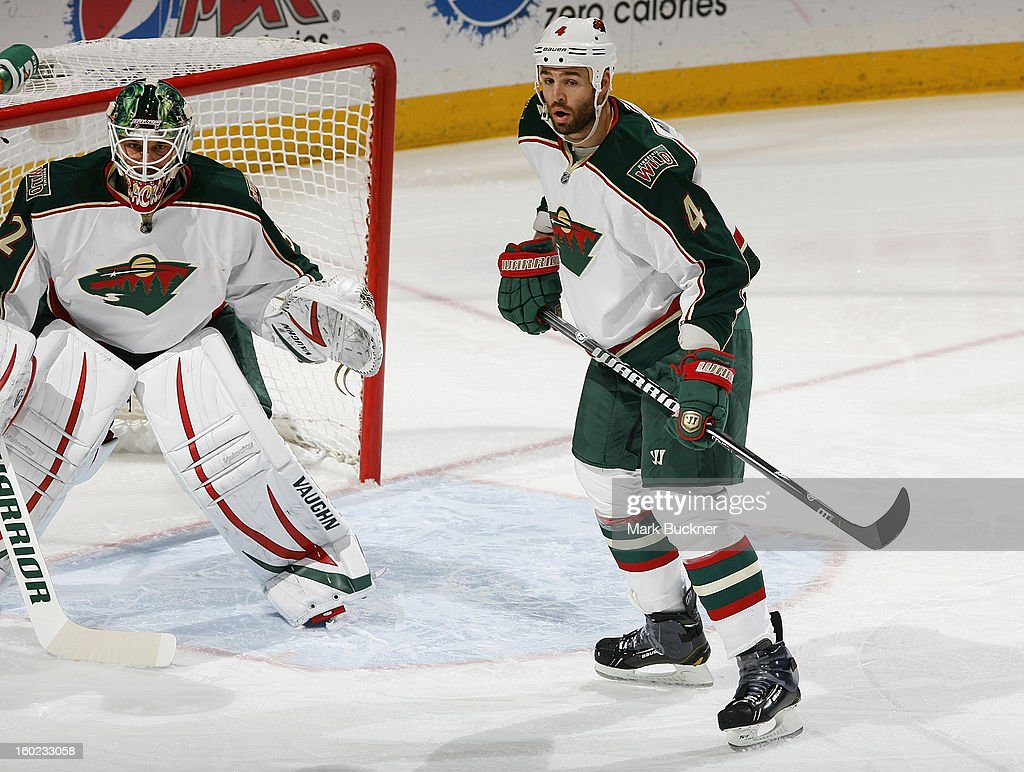 Clayton Stoner #4 and goalie Niklas Backstrom #32 of the Minnesota Wild defends against the St. Louis Blues in an NHL game on January 27, 2013 at Scottrade Center in St. Louis, Missouri.