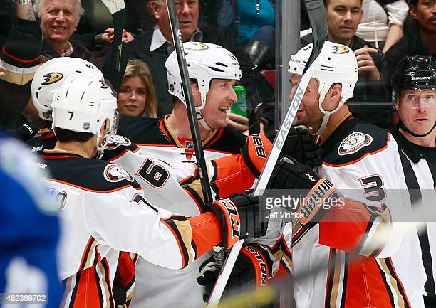 Clayton Stoner and Tim Jackman celebrate a goal by Rickard Rakell of the Anaheim Ducks against the Vancouver Canucks during their NHL game at Rogers...