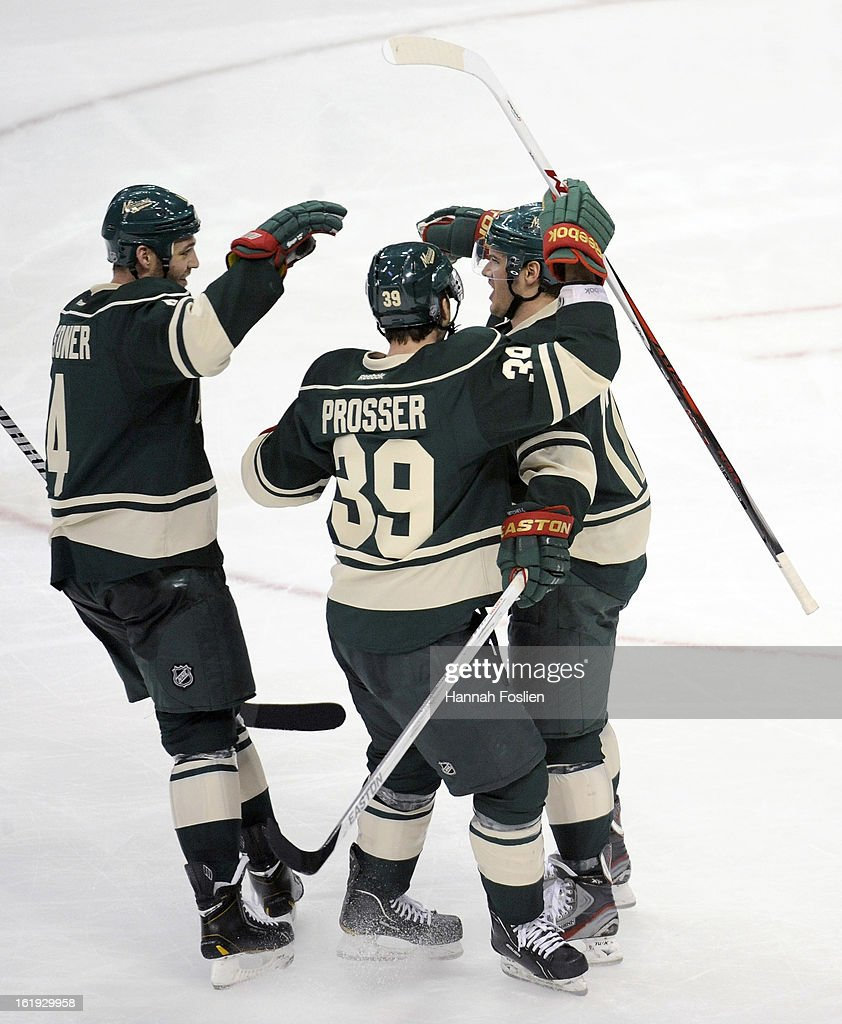 <a gi-track='captionPersonalityLinkClicked' href=/galleries/search?phrase=Clayton+Stoner&family=editorial&specificpeople=2222214 ng-click='$event.stopPropagation()'>Clayton Stoner</a> #4, Nate Prosser #39 and <a gi-track='captionPersonalityLinkClicked' href=/galleries/search?phrase=Torrey+Mitchell&family=editorial&specificpeople=4504539 ng-click='$event.stopPropagation()'>Torrey Mitchell</a> #17 of the Minnesota Wild celebrate a goal by Mitchell during the second period of the game against the Detroit Red Wings on February 17, 2013 at Xcel Energy Center in St Paul, Minnesota. The Wild defeated the Red Wings 3-2.
