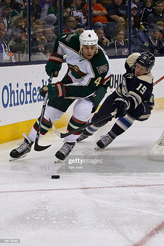 Clayton Stoner #4 of the Minnesota Wild and Ryan Johansen #19 of the Columbus Blue Jackets chase after a loose puck on April 7, 2013 at Nationwide Arena in Columbus, Ohio.