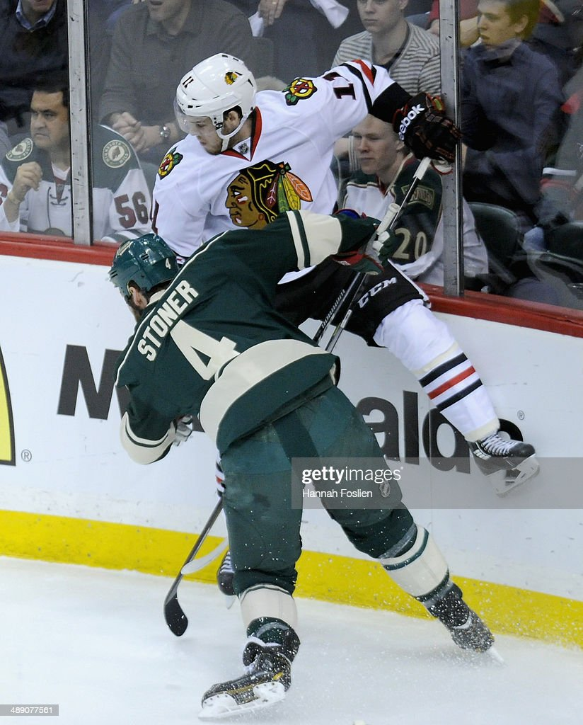 Clayton Stoner #4 of the Minnesota Wild checks Jeremy Morin #11 of the Chicago Blackhawks into the boards during the first period in Game Four of the Second Round of the 2014 NHL Stanley Cup Playoffs on May 9, 2014 at Xcel Energy Center in St Paul, Minnesota. The Wild defeated the Blackhawks 4-2.
