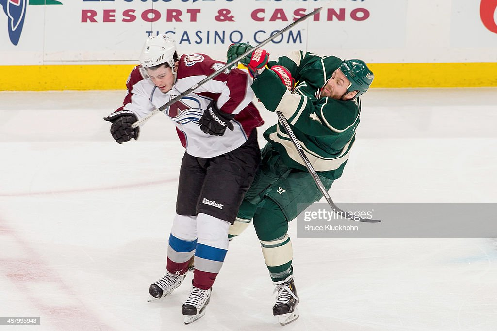 <a gi-track='captionPersonalityLinkClicked' href=/galleries/search?phrase=Clayton+Stoner&family=editorial&specificpeople=2222214 ng-click='$event.stopPropagation()'>Clayton Stoner</a> #4 of the Minnesota Wild collides with <a gi-track='captionPersonalityLinkClicked' href=/galleries/search?phrase=Matt+Duchene&family=editorial&specificpeople=4819304 ng-click='$event.stopPropagation()'>Matt Duchene</a> #9 of the Colorado Avalanche during Game Six of the First Round of the 2014 Stanley Cup Playoffs on April 28, 2014 at the Xcel Energy Center in St. Paul, Minnesota.