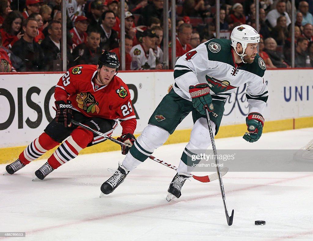 <a gi-track='captionPersonalityLinkClicked' href=/galleries/search?phrase=Clayton+Stoner&family=editorial&specificpeople=2222214 ng-click='$event.stopPropagation()'>Clayton Stoner</a> #4 of the Minnesota Wild is chased by <a gi-track='captionPersonalityLinkClicked' href=/galleries/search?phrase=Bryan+Bickell&family=editorial&specificpeople=241498 ng-click='$event.stopPropagation()'>Bryan Bickell</a> #29 of the Chicago Blackhawks in Game Two of the Second Round of the 2014 NHL Stanley Cup Playoffs at the United Center on May 4, 2014 in Chicago, Illinois. The Blackhawks defeated the Wild 4-1.