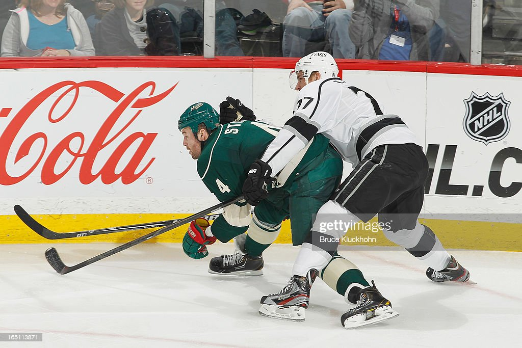 <a gi-track='captionPersonalityLinkClicked' href=/galleries/search?phrase=Clayton+Stoner&family=editorial&specificpeople=2222214 ng-click='$event.stopPropagation()'>Clayton Stoner</a> #4 of the Minnesota Wild is defended closely by <a gi-track='captionPersonalityLinkClicked' href=/galleries/search?phrase=Jeff+Carter&family=editorial&specificpeople=227320 ng-click='$event.stopPropagation()'>Jeff Carter</a> #77 of the Los Angeles Kings during the game on March 30, 2013 at the Xcel Energy Center in Saint Paul, Minnesota.