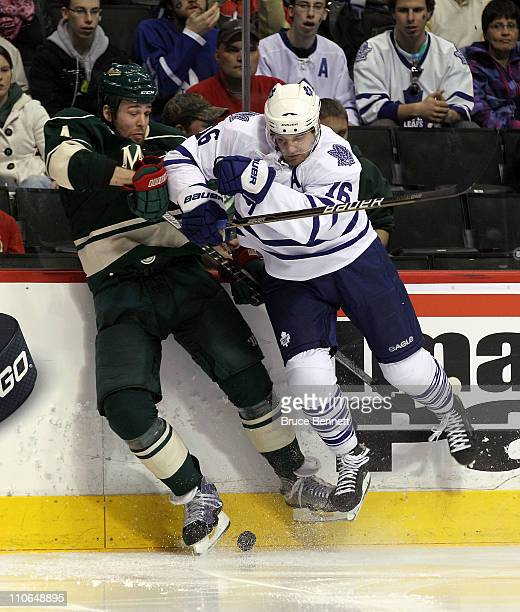 Clayton Stoner of the Minnesota Wild is run into by Clarke MacArthur of the Toronto Maple Leafs at the Xcel Energy Center on March 22 2011 in St Paul...