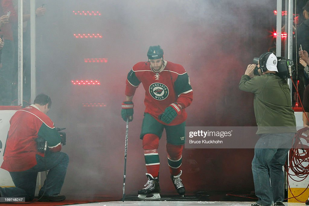 <a gi-track='captionPersonalityLinkClicked' href=/galleries/search?phrase=Clayton+Stoner&family=editorial&specificpeople=2222214 ng-click='$event.stopPropagation()'>Clayton Stoner</a> #4 of the Minnesota Wild makes his way onto the ice during pre-game introductions prior to the game against the Colorado Avalanche on January 19, 2013 at the Xcel Energy Center in Saint Paul, Minnesota.