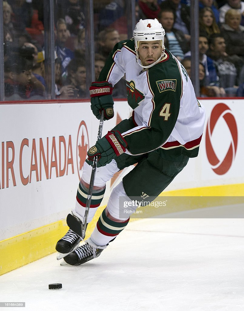 Clayton Stoner #4 of the Minnesota Wild skates with the puck during NHL action against the Vancouver Canucks on February 12, 2013 at Rogers Arena in Vancouver, British Columbia, Canada.