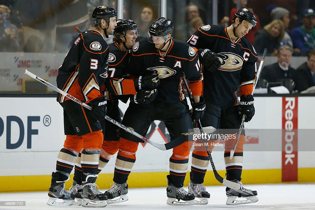 Clayton Stoner #3, Rickard Rakell #67, Corey Perry #10 and Ryan Getzlaf #15 of the Anaheim Ducks react to a goal during the third period of a game at Honda Center on November 30, 2015 in Anaheim, California.