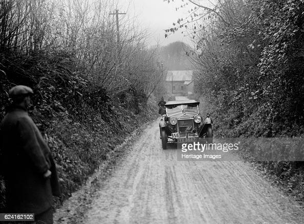 CL Clayton's Alfa Romeo competing in the MCC Exeter Trial 1930 Artist Bill BrunellAlfa Romeo 1487 cc Vehicle Reg No YX3647 Event Entry No 158 Driver...