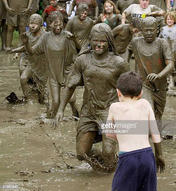 A clean child is about to fall in the mud during Mud Day at the Hines Park in Westland Michigan on O9 July 2002 Wayne County Michigan parks...