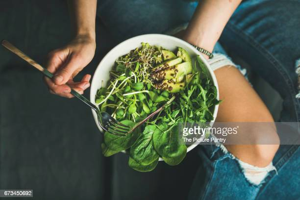 Clean eating breakfast with spinach, arugula, avocado, seeds and sprouts